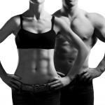 bigstock-man-and-a-woman-in-the-gym-26274188